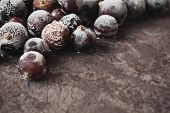 picture of frozen food  - frozen berries of black currant on a marble table.health and diet food. selective focus. copy space background