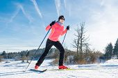 stock photo of nordic skiing  - Woman cross country skiing on a yellow skis - JPG