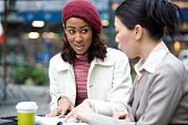 foto of business meetings  - Two business women having a casual meeting or discussion in the city - JPG