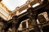 pic of pilaster  - Sunlight on Adalaj Stepwell in Ahmedabad Gujarat India - JPG
