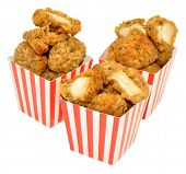 foto of fried chicken  - Southern fried chicken nuggets and French fries in red and white striped boxes - JPG