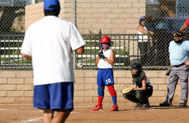"""pic of fastpitch  - """"some photoshop done to eliminate all logos"""".  Focus is on batter getting the sign from the coach, who is in a soft focus. - JPG"""