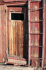 stock photo of caboose  - Red door on caboose used as a dwelling in ghost town at Rhyolite - JPG