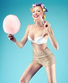picture of candy cotton  - Happy beautiful young woman eating candy cotton - JPG