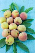 stock photo of peach  - group of fresh peaches on wood background - JPG