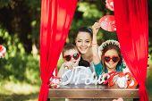 picture of handphone  - Happy smiling family on nature photoshoot Happy smiling family on nature photoshoot - JPG