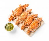 pic of cooked blue crab  - Steamed flower crab served on wooden chopping board with spicy chili dip sauce - JPG