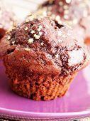 foto of chocolate muffin  - Homemade chocolate muffins close up shot from below - JPG