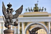 stock photo of winter palace  - Details of fence decoration with Russian Imperial Symbol of Double Headed Eagle at Palace Spuare behind blured view of gate to Palace Square St - JPG