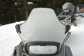 picture of headlight  - Frosted snowmobile windshield and headlight in winter - JPG