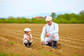 picture of grandpa  - grandpa explaining his grandson the way plants are grow - JPG