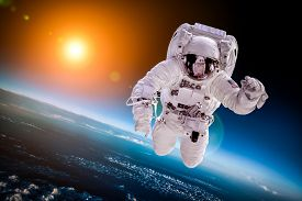 image of outer  - Astronaut in outer space against the backdrop of the planet earth - JPG