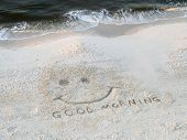 image of happy-face  - beach coastline with good morning happy face drawn in sand - JPG