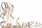 picture of new years celebration  - glass of champagne and streamers in sepia - JPG