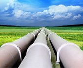 stock photo of aqueduct  - gas pipe line that laid through green field - JPG