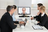 Постер, плакат: Businesspeople Videoconferencing With Doctors