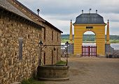 stock photo of acadian  - louisbourg main entrance via the docks with the arch in the background - JPG