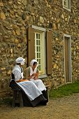 stock photo of acadian  - girls of louisbourg taking a quick break to have a talk - JPG
