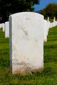picture of antichrist  - Headstone in a graveyard with evil 666 engraving with clipping path - JPG