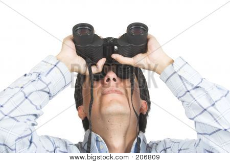 Picture or Photo of Business man searching for something using binoculars over a white background