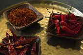 Close-up of red chilies, dried red chili pepper and crushed red pepper in plate poster