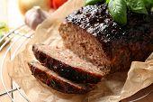 Tasty baked turkey meatloaf on cooling rack poster