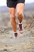 Sport athlete man running shoes trail desert run training cardio for marathon race. Legs of runner h poster