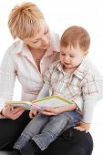 Mother and baby embracing in affectionate moment, reading book. poster