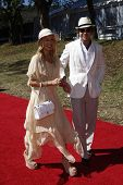 LOS ANGELES - OCT 10:  Rachel Zoe and husband Rodger Berman arriving at the Veuve Cliquot Polo Class