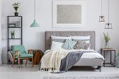 Adorable Bedroom With Mint Chair poster