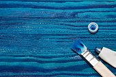 Beautiful Wooden Background Painted With Bright Blue Paint. Open A Tube Of Paint And Brushes poster