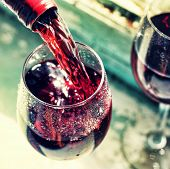 Pouring Red Wine. Wine In A Glass, Selective Focus, Motion Blur, poster