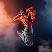Performer Dancing On Dark Background poster