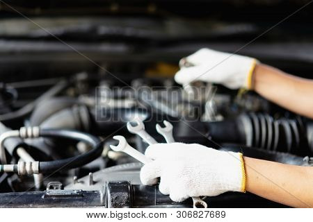 poster of The Car Mechanic Is Checking The Engine Oil Level.auto Mechanic Preparing For The Work.close Up Of H