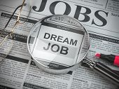 Dream job concept. Job search and employment. Magnified glass with job classified ads in newspaper,  poster