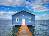 Tourist Attraction Of Blue Boat House.with Sky Blue Above Background, Perth, Australia.. poster