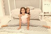 Gymnast Practice Split With Friend. Girl Child Sit Split In Bedroom. Friends Gymnasts Support Each O poster