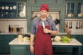 Man Chef Wear Apron Cooking In Kitchen. Man Use Sharp Ceramic Knife. Sharp Knife Professional Tool.  poster