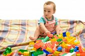 Improving His Early Skills. Cute Boy Child Building Bricks. Little Baby Play Construction Game. Litt poster