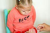 Little Girl Afraiding Of Trimming Fingernails By Manicure Scissors poster