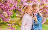 Romantic Babies. Kids Enjoying Pink Cherry Blossom. Tender Love Feelings. Couple Kids On Flowers Of  poster