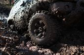 Detailed View Of Motion The Wheels Tires And Off-road Truck Shaft That Goes In The Snow And Mud Thro poster