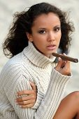 Portrait Of A Beautiful Girl With A Cigar In The Sand