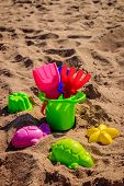 Sand Bucket And Shovels On Sand. Childrens Games. Sand Games. poster