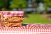 Picnic Basket On A Table With A Red Tablecloth. Summer Mood. Relaxation. Holidays poster