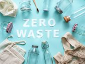 Zero Waste Concept. Textile Eco Bags, Glass Jars And Bamboo Toothbrush On Blue Background With Zero  poster