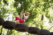 Eco Resort Activities. Climber Little Girl On Training. Children Fun. Rope Park. Active Children. Pl poster
