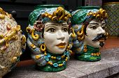 stock photo of sicily  - Ceramic Heads along the shopping lanes of Taormina Sicily not far from the GrecoRoman Theater - JPG