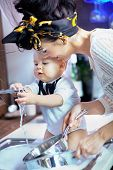 picture of mother child  - Beautiful baby help with washing - JPG