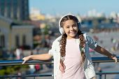 The World Beyond My Headphones Is Too Chaotic. Little Girl Wearing Headphones On Urban Outdoor. Cute poster
